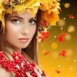 Beautiful young woman with yellow autumn wreath outdoors — Stock Photo #56213177