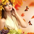 Beautiful young woman with yellow autumn wreath outdoors — Stock Photo #56213187