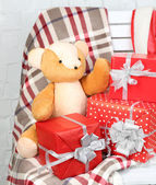 Christmas presents on blanket on white chair closeup — Foto Stock
