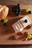 Still life with tasty cheese, grape and bread, close up — Stock Photo