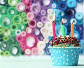 Delicious birthday cupcake on bright background — Stock Photo