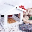 Handmade birdhouse in winter — Stock Photo #56280419