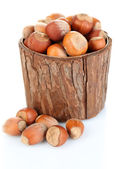 Hazelnuts in wooden bowl isolated on white — Stock Photo