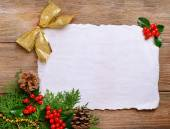 Christmas decoration with paper shit on wooden background — Stock Photo