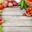 Summer frame with fresh organic vegetables and fruits on wooden background — Stock Photo #56341231