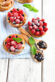 Sweet cakes with berries on table close-up — Stock Photo