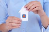 Woman hands holding paper house close up — Stock Photo