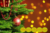 Decorated Christmas tree on  blurred, sparkling and fairy background — Stock Photo