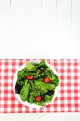 Fresh green salad in bowl on wooden table — Stock Photo