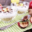 Oatmeal in bowls, yogurt, apples and walnuts on napkin on brown wooden background — Stock Photo #56352333