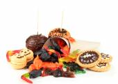 Different sweets for Halloween party, isolated on white — Stock Photo