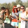 Young friends having barbecue party, outdoors — Stock Photo #56384537