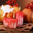 Composition of pumpkin, candle and Halloween decorations — Stock Photo #56386943