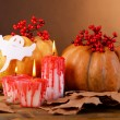 Composition of pumpkin, candle and Halloween decorations — Stock Photo #56386957