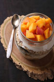 Yogurt with fresh peach — Stock Photo
