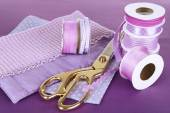 Ribbons with scissors and fabrics — Stock Photo