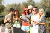 Young friends having barbecue party, outdoors — Stockfoto