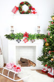 Christmas tree near fireplace in room — Stok fotoğraf
