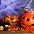 Composition for Halloween with sweets on wooden table — Stockfoto #56463029