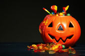 Composition for Halloween with sweets on dark background — Stock Photo
