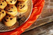 Halloween with sweets on wooden table — Stock Photo