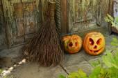 Pumpkin and broom for holiday Halloween — Stock Photo