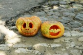 Pumpkins for holiday Halloween on paved road — Stock Photo