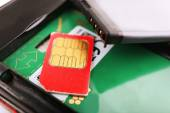 Cell phone and sim card, close up — Stock Photo