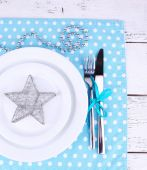 White plates, fork, knife and Christmas decoration — Stock Photo