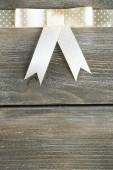 Beautiful bow on wood — Stock Photo