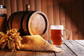 Beer barrel with beer glass — Stock Photo