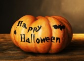 Halloween pumpkin on wooden table on dark color background — 图库照片