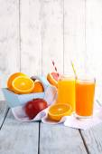 Orange and carrot juice in glasses — Stock Photo