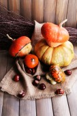 Pumpkins in box on sackcloth — Stock Photo