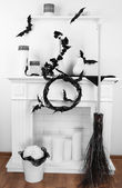 Halloween composition on fireplace in room — Stock Photo