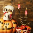 Halloween pumpkins and candies — Stock Photo #56586469