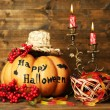 Halloween pumpkins and candies — Stock Photo #56586475