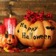 Halloween pumpkins and candies — Stock Photo #56586487