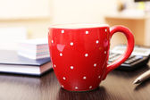 Cup of tea in office — Stock Photo