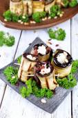 Fried aubergine with cottage cheese and parsley on wooden background — 图库照片