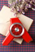 Retro hairdryer and book on table, close up — Stock Photo
