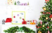 Christmas tree near fireplace in room — Stock Photo