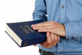 Man holding Bible isolated on white — Stock Photo