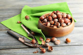 Hazelnuts in wooden bowl — Stock Photo
