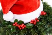 Leaves of mistletoe with Christmas hat — Stock fotografie