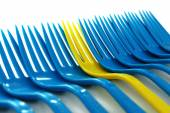 Individuality concept. Plastic disposable tableware, close-up — Stock Photo