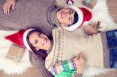 Happy couple with Christmas gifts relaxing at home — Stock Photo