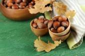 Hazelnuts in wooden bowls — Stock Photo