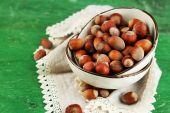 Hazelnuts on plate on napkin — Stock Photo