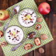 Oatmeal with yogurt in bowls, apples and walnuts — Stock Photo #56864065
